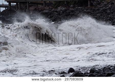 Rolling Wave On Stone Coastline At Storm. Portuguese Island Of Madeira