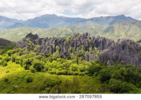 Sharp Needles Of Black Volcanic Peaks. Mountains Near Mont Aoupinie And Poya River, Aerial View. Nor