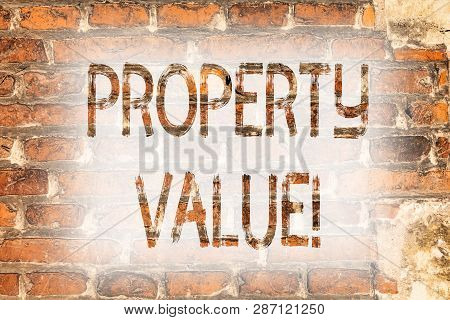 Writing note showing Property Value. Business photo showcasing Estimate of Worth Real Estate Residential Valuation Brick Wall art like Graffiti motivational call written on the wall. poster