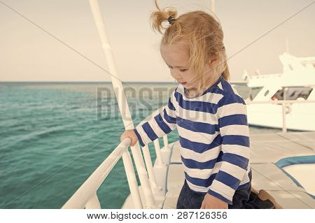 Family Cruise Vacations. Kid Boy Toddler Travelling Sea Cruise. Child In Striped Shirt Looks Like Yo