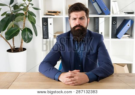 Report And Complaint Concept. Man Bearded Hipster Boss Looking At You With Attention. Boss Sit In Of