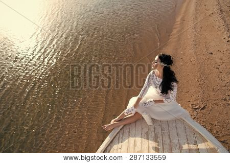 Bride Adorable White Wedding Dress Sunny Day Sit On Boat Or Ship. Honeymoon Sea Beach. Things Consid