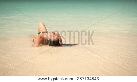Paradisaic Delight. Girl Sexy Bikini Lay Relaxing Turquoise Ocean Water Lagoon. Woman On Vacation Re