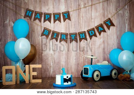 Photoshoot Crush Smashcake For A Little Boy Gentleman. Decorated Photozone With A Wooden Retro Car A