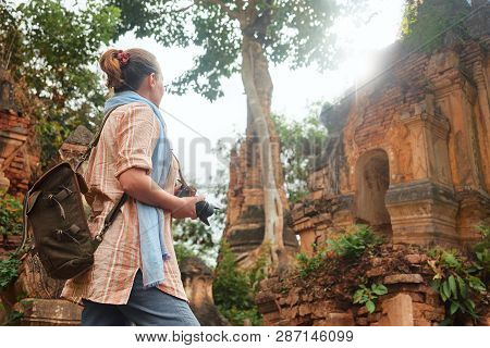 Woman Tourist Enjoying View Looking At Buddhist Ancient Temple In Indein. Burma, Asia.  Traveling Al