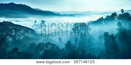 Beautiful Landscape Of Mountains And Rainforest In Early Morning Sun Rays And Fog Near Village Ngapa