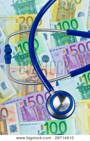many euro bank notes with stethoscope