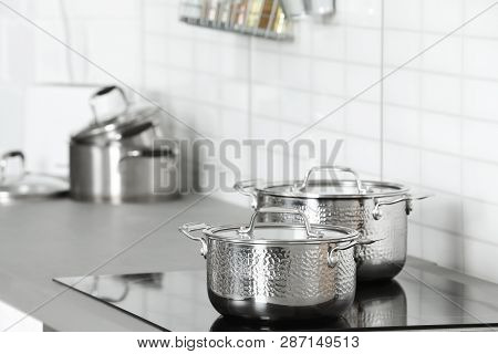 Clean Pans On Stove In Kitchen. Space For Text