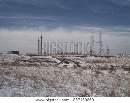 Outdoor Electrical Substation High Voltage. Transformer substation high voltage electrical network. Industrial energy. The outskirts of the city of Ust-Kamenogorsk (Kazakhstan). Grunge Landscape poster