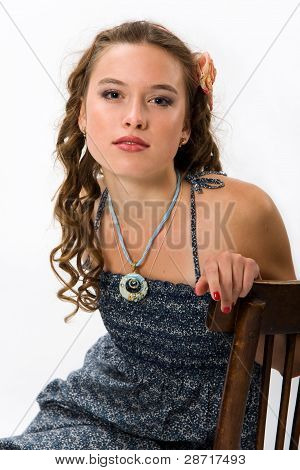 Portrait Of A Pretty Young Girl With Clean Skin. Girl With Long Curly Hairs.