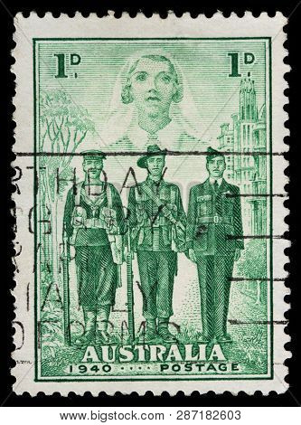 Luga, Russia - February 13, 2019: A Stamp Printed By Australia Shows Sailor, Soldier, Pilot And Nurs