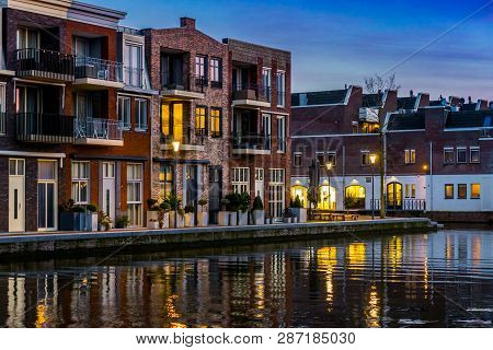 Dutch Houses At The Canal By Night, City Architecture Of Alphen Aan Den Rijn, The Netherlands