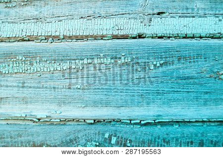 Texture wooden background - wooden weathered texture planks covered with old peeling paint of turquoise color, texture background with peeling paint