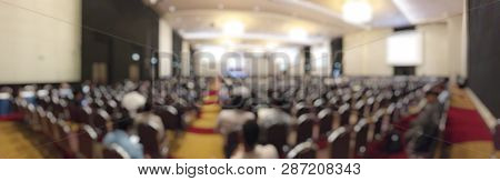 Abstract Blurred Image Of People In Seminar Room Or Conference Hall For Profession Seminar And The S