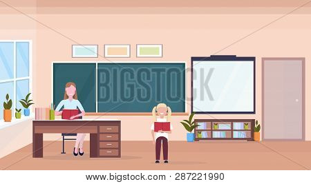 Woman Teacher Sitting At Desk Schoolgirl Reading Book Education Concept Modern School Classroom Inte
