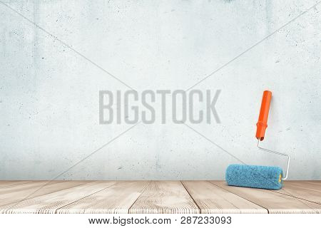 3d Rendering Of Paint Roller On White Wooden Floor And White Wall Background