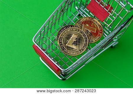 Colse Up Shot Of Gold Litecoins In A Basket Shot On Chroma Key. Studio Shot Of Little Tiny Metal Sho