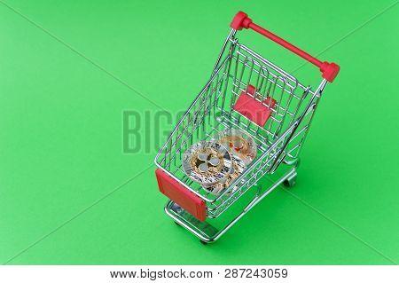 Colse Up Shot Of Quarkcoin In A Basket Shot On Chroma Key. Studio Shot Of Little Tiny Metal Shop Bas