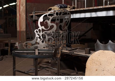 Handmade Metal Chair With Ornament In Blacksmith Workshop. Handmade Beautiful Metal Chair In Blacksm