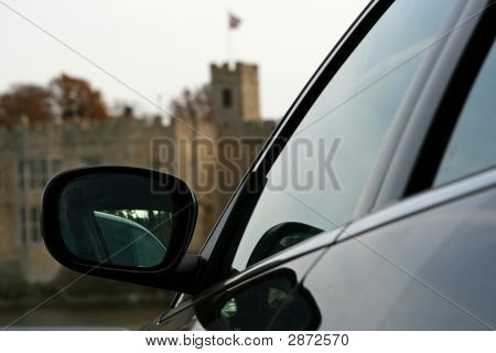 Black Car Wing Mirror With Castle Background