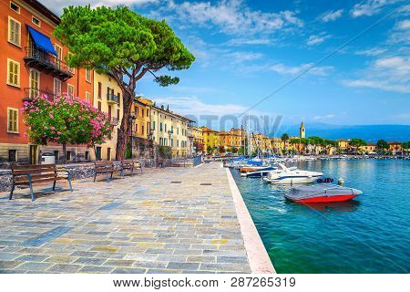 Wonderful Paved Walkway With Colorful Mediterranean Flowers. Luxury Yachts, Boats And Sailing Boats