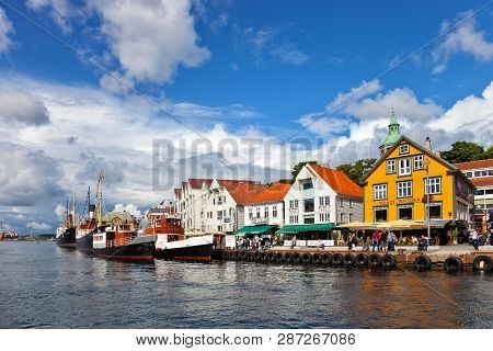 Stavanger, Norway - August 04, 2017: People At The Quay Port With Many Restaurants And Pubs In The C