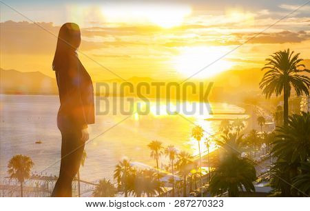 Young Woman Looking Over The Cannes At Sunset