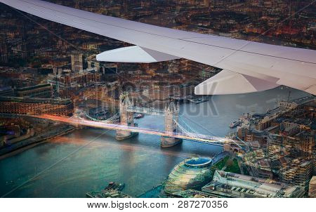 Tower Bridge And River Thames. View From The Airplane. London At Dusk