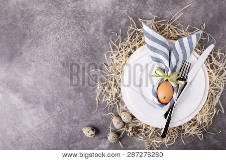 Beautiful Easter Table Setting With Egg In Napkin Easter Bunny. Top View.
