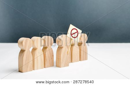 People Go Outside And Join The Protest Movement. An Angry Mob Of Wooden Figures Of People With A Pos