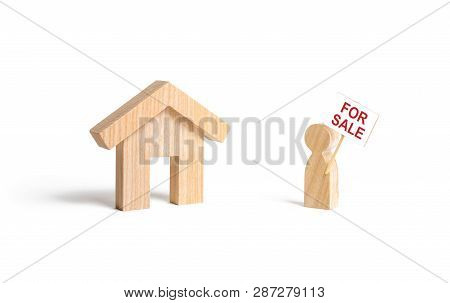 A Man With A Poster For Sale Stands Near The House On An Isolated Background. Concept Of Selling A H