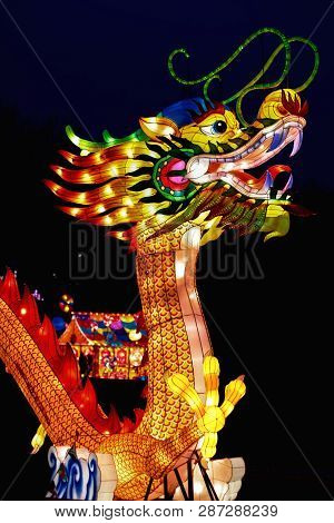 Chinese Lantern Festival with bright glowing figures. Colorful Chinese lantern traditional legendary fiery animal of the Chinese dragon. Chinese New Year, Spring Festival Festival poster