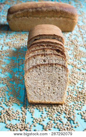 Lentil Sourdough Bread On A Blue Table Board