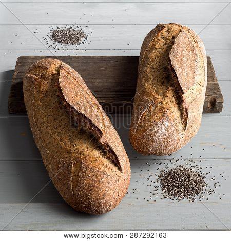 Chia Whole Wheat Bread On A Gray Wooden Board