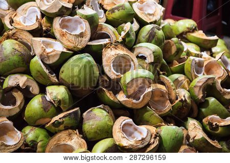 Natural Agricultural Waste, Chopped Coconut Fruits, Shells And Husks In Front Of Bakery Shop In Food