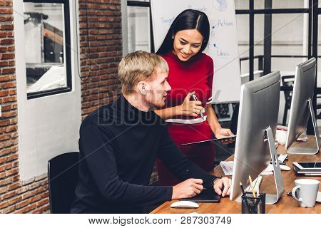 Two Business People Working And Discussing Strategy With Laptop Computer.creative Business People Pl