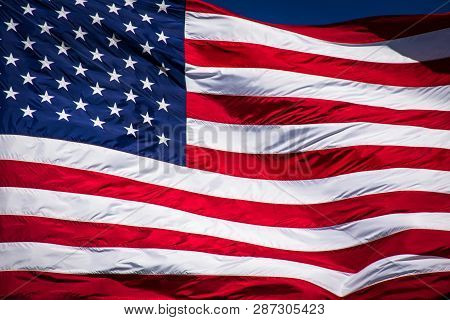 4th Of July American Flag Waving In The Wind On A Perfect Sunny Day With Blue Sky Background , Memor