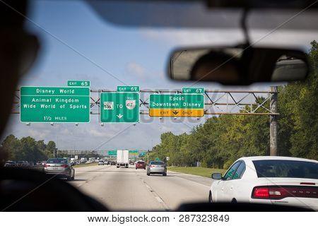 Florida, Usa, May 23, 2013: Road Leading To Walt Disney World. On The Road, Turn Indicators In Disne