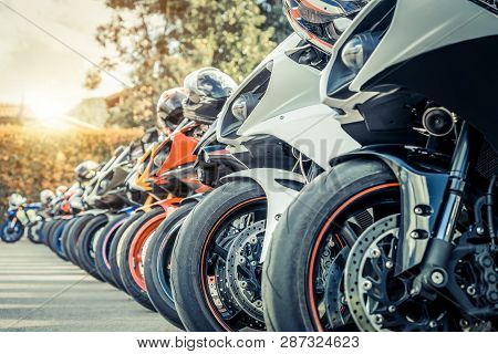 Motorcycles Group Parking On City Street In Summer