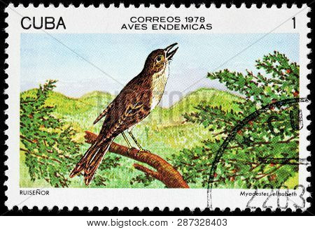 Luga, Russia - February 17, 2019: A Stamp Printed By Cuba Shows Cuban Solitaire, Also Known As Cuban