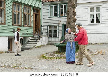 Bergen, Norway - July 21, 2018: Costumed Actors Playing In Gamle Bergen Museum - Old Bergen Museum -