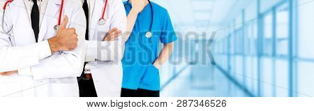 Doctor Working In Hospital With Other Doctors.