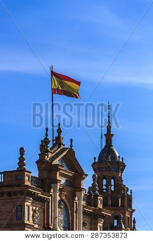 Seville, Spain - Dec 2018: National Flag If Spain Flying High At Spain Square, Maria Luisa Park