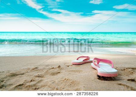 Pink And White Sandals On Sand Beach. Casual Style Flipflop Were Removed At Seaside. Summer Vacation