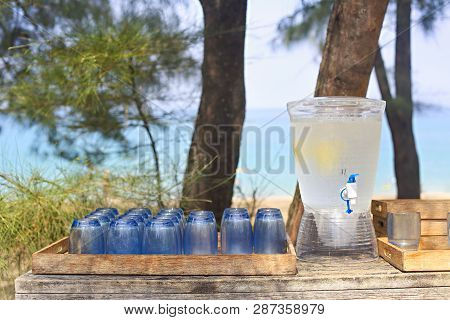Glass Jar Of Lemonade On The Candy Bar By The Sea