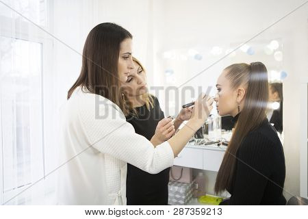 Makeup Teacher With Her Student Girl. Make Up Tutorial Lesson At Beauty School. Make Up Artist Work