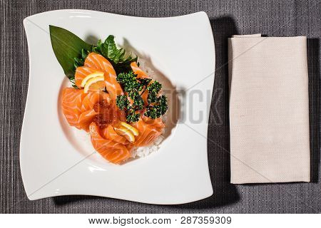 fillets of salmon with caviar on a bed of white rice, asian fusion cousine poster