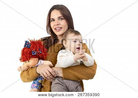 Loving Mother And Her Baby Girl With The Toy Isolated On White Background