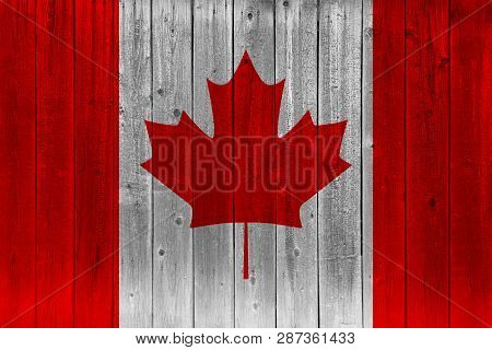 Canada Flag Painted On Old Wood Plank. Patriotic Background. National Flag Of Canada