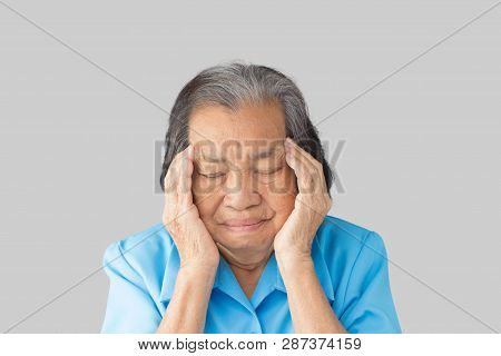Stressed exhausted grandmother having strong tension headache on a gray background poster